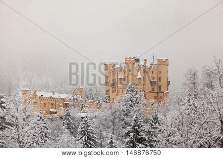 Hohenschwangau Castle in winter landscape in Germany