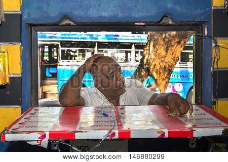 COLOMBO SRI LANKA - FEBRUARY 16 2016: Unidentified man waiting for his purchase on a booth on Colombo market.