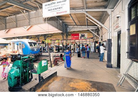 COLOMBO SRI LANKA - FEBRUARY 16 2016: Unidentified passengers in Colombo fort railway station indoor.