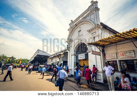 COLOMBO SRI LANKA - FEBRUARY 16 2016: Unidentified passengers in front of Fort Railway Station in Colombo.