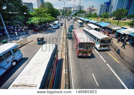 COLOMBO SRI LANKA - FEBRUARY 16 2016: Unidentified people on Colombo streets and traffic in the middle of the day