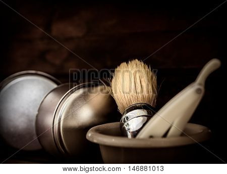 barber shop accessories with razor and soap brush toned in old style