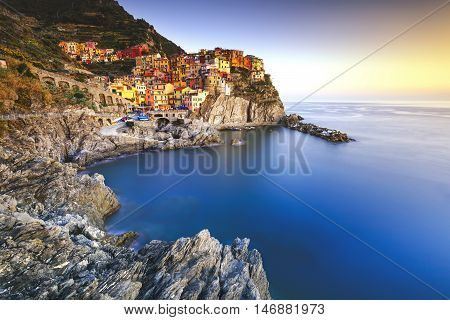 Manarola village on cliff rocks and sea at sunset. Seascape in Five lands Cinque Terre National Park Liguria Italy Europe. Long Exposure