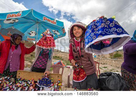 KIRGKGOZ SARATLI CAPPADOCIA TURKEY - MAY 4: Unidentified women selling Cappadocia dolls in front of underground city in Kirgkoz Saratli in Cappadocia.