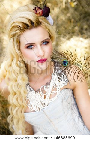 Blonde woman with long curly hair with flower accessory in antique corset and underwear poster