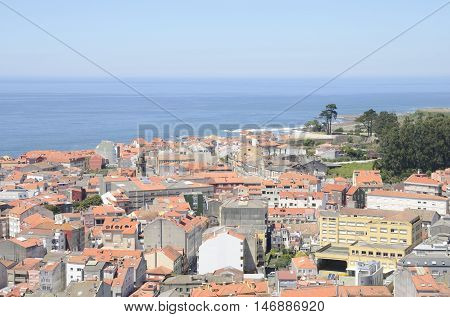 View of the village of A Guarda over the Atlantic Ocean from the mountain of Santa Tecla in Galicia Spain.