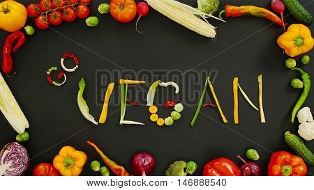 Vegetables made word go vegan. Vegetables made of word go vegan. Vegetables on a black background. Word go vegan on a black background.
