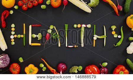 Vegetables made word healthy. vegetables made of word healthy. vegetables on a black background. Word healthy on a black background.