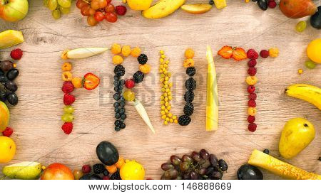 Fruits made word fruit. Fruits on a white background. Fruits on a table.