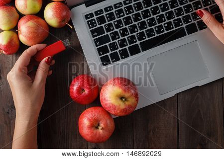 Close Up Of A Woman Hand Plugging  Red Pendrive On A Laptop