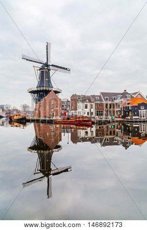 Picturesque windmill and traditional houses, Haarlem, Holland