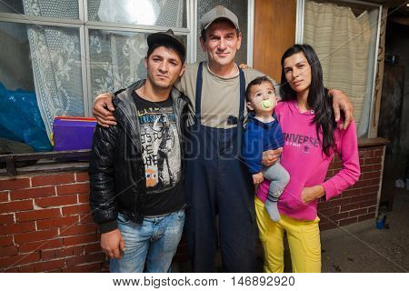 ZAGREB, CROATIA - OCTOBER 21, 2013: Roma family posing in front of their house.