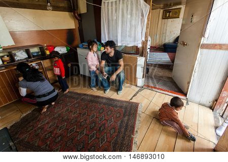 ZAGREB, CROATIA - OCTOBER 21, 2013: Roma man and his family at their home.
