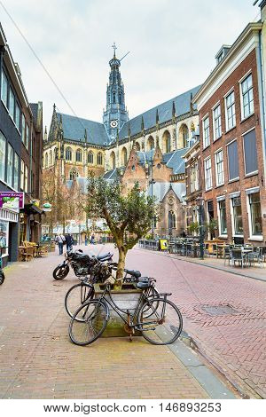 Haarlem, Netherlands - April 2, 2016: Street view with bicycles and church dome in Haarlem, Holland