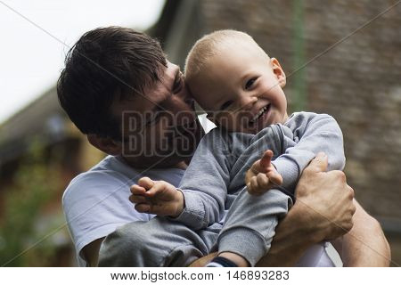 Boy and his uncle are laughing and enjoying together.