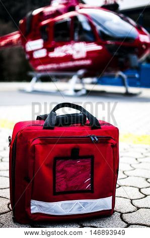 red emergency bag near a rescue helicopter