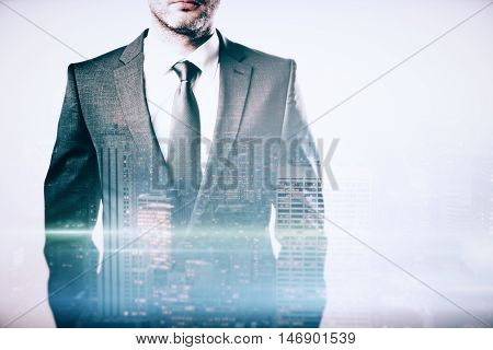 Closeup of businessperson's body in suit and tie on city background with abstract light. Double exposure