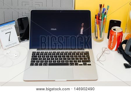 PARIS FRANCE - SEP 8 2016: Apple Computers website on MacBook Retina in room environment showcasing live coverage of Apple Keynote - iiWork suite eal-time collaboration for collaborative editing