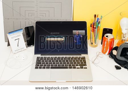 PARIS FRANCE - SEP 8 2016: Apple Computers website on MacBook Retina in room environment showcasing live coverage of Apple Keynote - Apple COO Jeff Williams on stage about waterproof apple watch