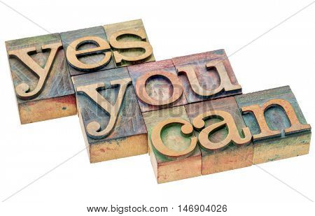 Yes you can word abstract - motivational slogan in vintage letterpress wood type, isolated on white