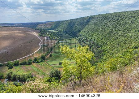 Moldavian village situated near nills with green forest