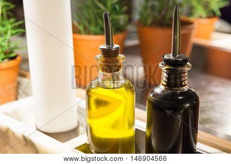 Olive Oil And Balsamic Vinegar In Glass Bottles