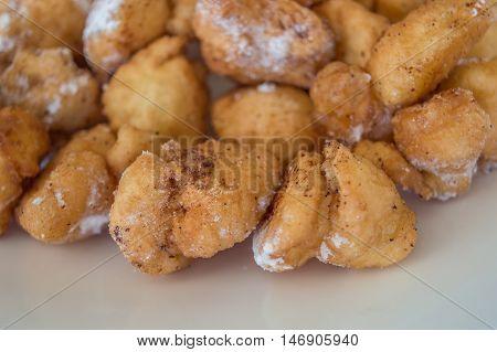 Ustipci, doughnut-like fried dough balls with sugar