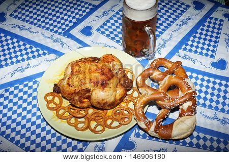 Bavarian meals for oktoberfest preparing on the bavarian national colours background