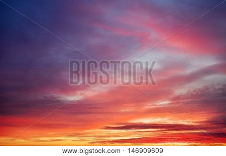 Beautiful fiery orange and red colorful sunset sky.