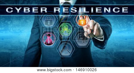 Male computer security manager is pushing the term CYBER RESILIENCE on an interactive control screen. Computing technology concept involving information security and business continuity metaphor.