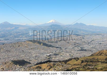 This photo shows a closer view of the valley of Quito city with Cotopaxi Volcano  in the background, this one too was taken from the cableway station.