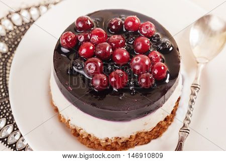 cake dessert with cranberry jelly cream cream round shape berries closeup