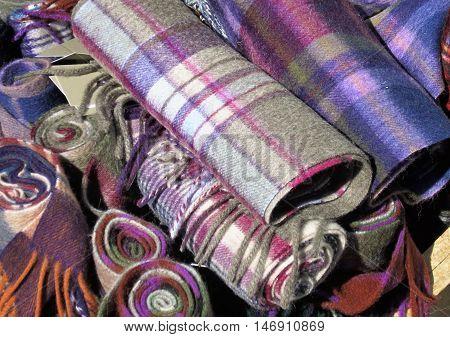 Multicolored Scottish tartan scarfs for sale outside a shop