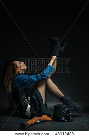 Vintage Girl Fixing Footwear.