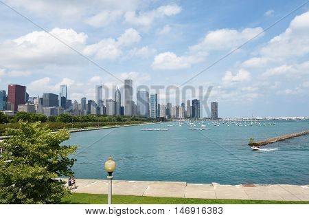 CHICAGO, ILLINOIS - SEPTEMBER 5, 2016: Chicago Skyline. Seen from the Shedd Aquarium looking across Monroe Harbor on Lake Michigan.
