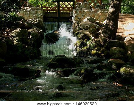Cascade of the park in Oliwa. Gdansk, Poland September 02, 2016 Small water cascade from the park Oliwa in Gdansk.