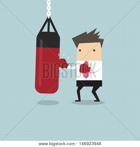 Businessman wearing boxing gloves and punching the punch bag