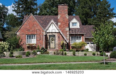 Quaint Brick House with Picket Fence