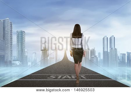 Back View Of Business Woman Walking To The Arrow