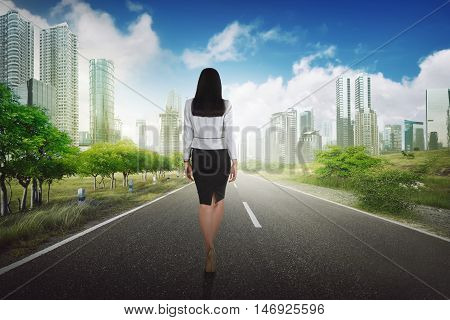 Success Business Woman Walking On The Road