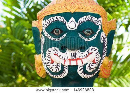 Carved Face Of A Statue. Temple In Thailand