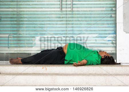 Homeless Sleeping On Top Of Footsteps In Bangkok