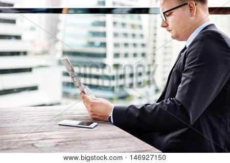 Man Working Reading Newspaper Connecting Networking Concept