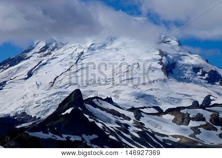 Icy top and crevasses  of Mount Baker in Cascade Mountains. Mount Baker National Forest. Bellingham. Washington. USA.