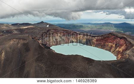 Maly Semyachik is a stratovolcano with acidic crater lake. Kronotsky Nature Reserve on Kamchatka Peninsula. View from helicopter.