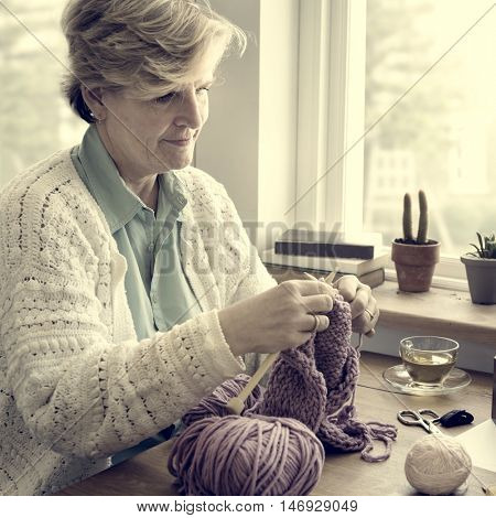 Woman Senior Adult Knitting Concept