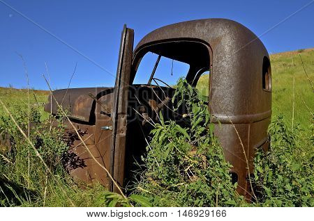 WATFORD CITY, NORTH DAKOTA, June 24, 2016: The old rusty International pickup is a product of The International Harvester Company which was a United States manufacturer of agricultural machinery, construction equipment, trucks, and  formed In 1902