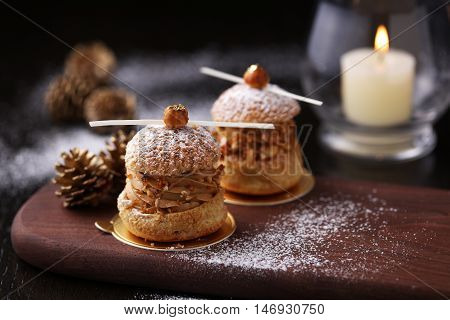 Hazelnut Choux on wooden plate with Christmas Setting
