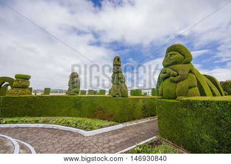 TULCAN, ECUADOR - JULY 3, 2016: the topiary of the cemetery is famous because of its prehispanic sculptures.