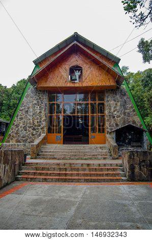 PASTO, COLOMBIA - JULY 3, 2016: small sanctuary of lourdes virgin located in la cocha lake.